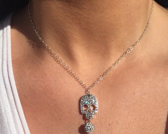 rhinestone skull charm necklace on silver plated chain