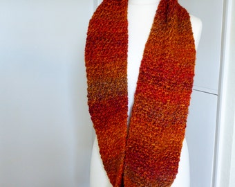 Beautiful chunky hand knitted infinity scarf from the new 'Teddy Bear' range in gorgeous oranges with a hint of red