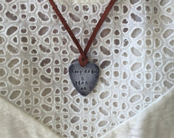 Keep calm and play on - Antique Distressed Silver Guitar Pick Hand Stamped Necklace Natural Medium Brown Leather Cord Adjustable 21""