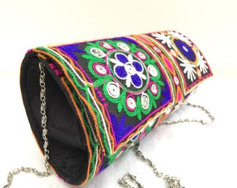 Roller Clutch bag made from black cotton fabric adorned with hand embroidered patterns and large silver sequins
