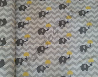 Grey chevron on it and graphite elephants with yellow umbrellas and cobalt birds with the trumpets  cotton fabric