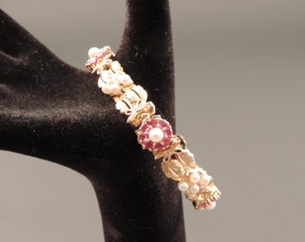 14 k gold wrist corsage with rubies and pearls