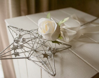 Silver flower girls flower wand with ivory rose and trailing ribbon.