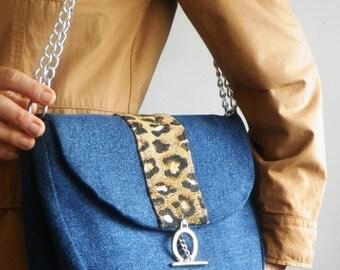 Denim shoulder bag with animal print trim