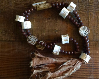Bone Beads with Brown Fabric Tassel