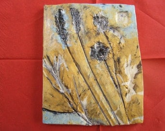 Tile, porcelain, impressed flowers and seed heads, by Brigitte