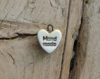 Heart shaped ceramic charms 'handmade'