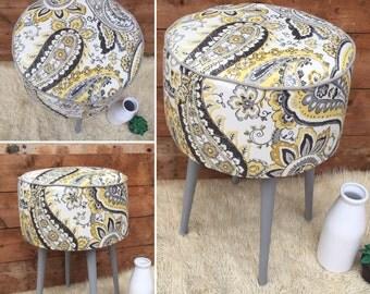 Upholstered footstool/sidetable ottoman