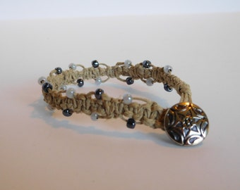 White and charcoal beaded hemp bracelet with silver button clasp