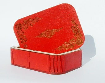 Red painted laser cut and engraved box.