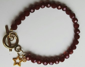 Beautiful bracelet of dark red faceted beads and Golden slot