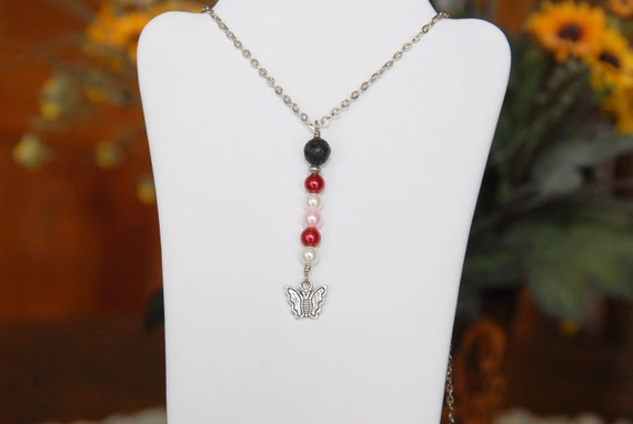 Lava Diffuser Y Necklace with Pink, Red and White Faux Pearls. Pewter Butterfly Pendant. Colors Nice for Valentines Day.