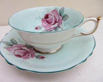 Pretty vintage Paragon Double Warrant duo English, fine bone china wide low footed Avon tea cup and saucer. Blue with pink roses. Tea party