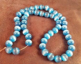 De-Stash - Sky Blue Cats Eye 8mm Beads
