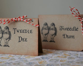 8 freestanding Alice in Wonderland themed wedding table place cards sittings