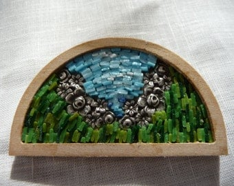 brooch on wood with flowers