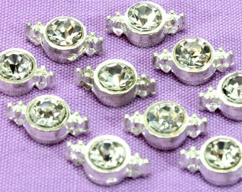 Two Hole Sliders With Clear Crystals (5) Silver Sliders. Two Strand Sliders. Crystal Sliders. Clear Rhinestone Sliders. Round Sliders. 10mm