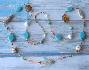 Lovely long vintage bead necklace with turquoise blue, white, brown, pink and faux carved ivory beads
