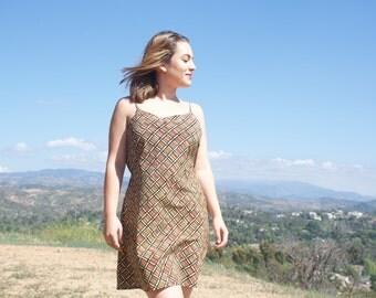 90s does 70s plaid spaghetti strap dress