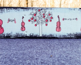 Black and white wall hanging with violins