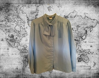 Plus Size ...Long sleeved blouse ... light blue...Size 42...Brand:Alicia