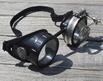 STEAMPUNK GOGGLES, Black with Clear Lenses, Silver Accents and Magnifying Loupes, Great for Halloween, Cosplay Costume or Birthday Gift