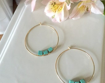 Gold hoops with turquoise stone detail