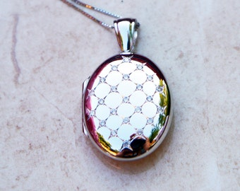 Solid 9ct White Gold Oval Locket with  0.23 cts of Diamonds MADE IN BRITAIN