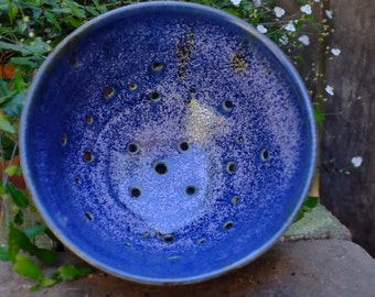 blue ceramic colander or berry bowl