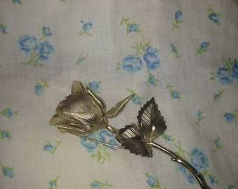 gold rose pin