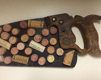 Vintage hand saw and wine cork wall art