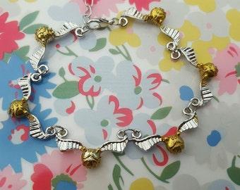 Harry Potter Golden Snitch Charm Bracelet. Gifts