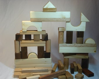 Wooden kids building blocks. All natural, sanded with smooth edges and a non-toxic food grade finish. By Bruce Hay.