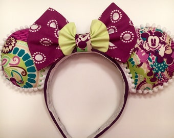 Vera Bradley fabric Minnie ears in purples, teals, and white. Very fun!
