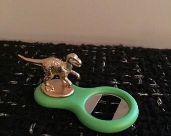 Small dinosaur bottle opener