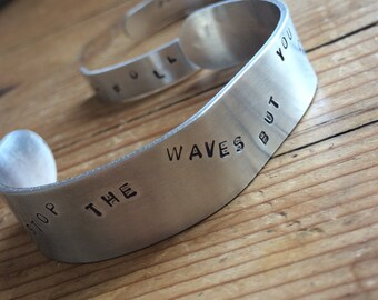You Can't Stop The Waves But You Can Learn To Surf'-Aluminium bracelet