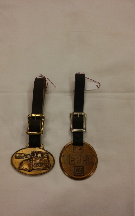 2 Vintage Advertising Watch FOBs from TEREX a Division of GM