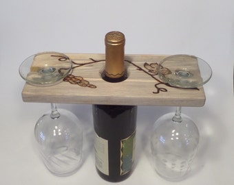 Wine and glass holder with grapevine woodburn
