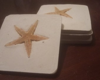Set of four star fish coasters