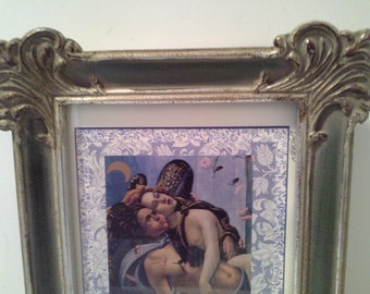 Sold Silver tone frame, with glass