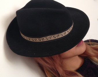 Black fedora hat with passamanerie.