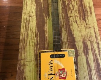 Don Tomas custom cigar box guitar