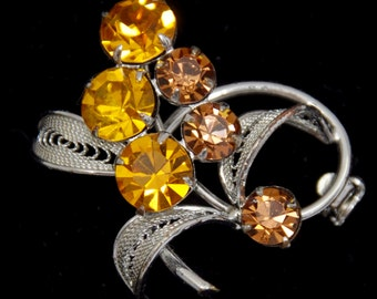 Vintage  Rhinestone Brooch with TOPAZ colored 8mm  Rhinestones that are prong set, circa 1940's
