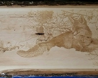 Winter's  Red Beauty, by Tami Elise, laser engraved on wooden plank.