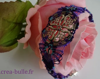 Bracelet woven around a Celtic print in shades of purple with inclusions of Turquoise beads
