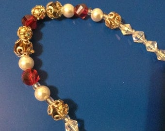 Orange Glass with cap and pearl necklace