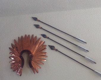 Copper headress and arrow