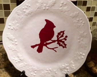 White decorative charger with red cardinal in vinyl