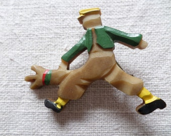 "1930's celluloid brooch ""golfer"""