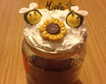 Honey jars with little bees